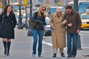 Helping man across the street